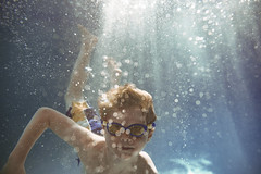 Like a fish (Elizabeth Sallee Bauer) Tags: active bonding boy child childhood children family fun girl goggles happiness hotel kid playing pool qualitytime swimming swimmingpool together underwater vacation water youth