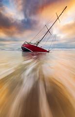 Tempus fugit (robjdickinson) Tags: ocean noperson boat sea water sky wave nature landscape ship transportation vessel beach watercraft yacht sun shore windwave rjdlandscapes