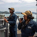 A Sailor uses a sound powered telephone on the starboard side bridge wing aboard the USS Ashland (LSD 48)