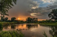 The rain is gone (piotrekfil) Tags: nature landscape sunset sun rain river water sky clouds reflections summer pentax poland piotrfil