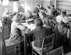 Quiet time (theirhistory) Tags: class school form pupils boy children kids girls jumper wellies dress skirt boots shoes