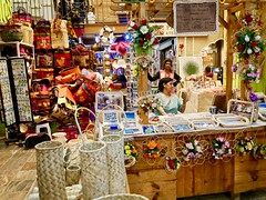 Indoor market (lesleydugmore) Tags: market mauritius  port portlouis stall gift brickabrac bag baskets flowers indoor