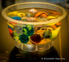 Day 299. (lizzieisdizzy) Tags: table tabletop marble marbles container pot plasticpot jellypot glass colourful bright