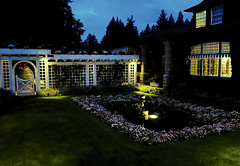 Twilight Tranquility (brucecarlson66) Tags: warm light bathes home homesite couryard butchart gardens victoria british columbia canada flowers window lattice trees sky peace solitude serenity grass green yellow white resident residential holland america cruise line tour inner passage travel vacation tranquility garden