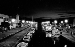 Sunset In Viareggio (michele.palombi) Tags: viareggio versilia tuscany mono film 35mm ilford hp5 sunset canale analogic night