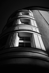 Sunset oriel (iamunclefester) Tags: münchen munich asatouristinmyhometown manualfocus manualfocusday street blackandwhite monochrome oriel sunset sun bright facade dark shadow round windows perspective lines sky balcony balustrade curvy curves