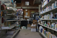 An aisle and cluttered book keeper's desk at Union Pharmacy located in Union Point, Georgia. Jim Carpenter, 72, from Madison, Georgia, and the owner and pharmacist, has been working there since 1969.