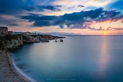 A long story to tell... (Emykla) Tags: tramonto sunset sicilia sicily nikon d3100 mare sea nuvole clouds sole sun faraglioni stacks terrasini spiaggia beach