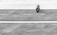 Top Man (DobingDesign) Tags: alone steps streetphotography lines stairs blackandwhite man minimal contrast outdoor publicrealm street sitting shadow seated resting rest takingabreak breaktime break pause abstract berlin staircase texture cobblestone stonework stone geometric pattern repeating repetitive