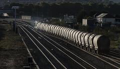 The Colas Caterpillar (powern56) Tags: wales southwales rogiet severntunneljunction railway railwaystation freighttrain colas colasrailfreight class70 70807 diesellocomotive backlight cement contrajour 6c37