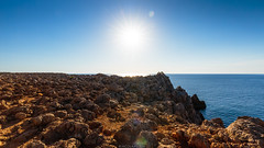 Punta Ses Selles (Nicola Pezzoli) Tags: menorca baleares baleari island nature spain sea minorca isola cliff rock red blue sky horizon sun flare sunshine