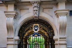 Trinity Hall (Sir Cam @camdiary) Tags: gate trinityhall cambridge camdiary cambridgeuniversity arms shield crescent moon face door