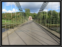 Union Bridge. Crossing The Border. (M E For Bees (Was Margaret Edge The Bee Girl)) Tags: chainbridge horncliffe northumberland bridge rivertweed scotland cables shadows lines sun summer blue sky clouds canon countyside water outdoors crossing metal chains