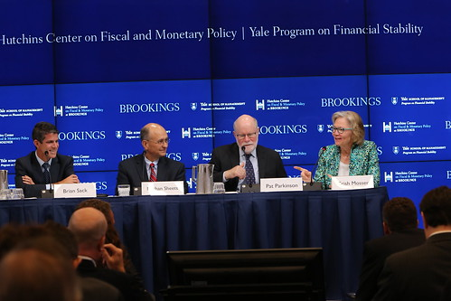 Moderator Brian Sack leads a panel with Nathan Sheets, Pat Parkinson, and presenter Trish Mosser on the role of the Federal Reserve in the early stages of the crisis