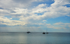 Mediterranean skies (angelsgermain) Tags: sky clouds sea water beach calm morning sails boats stillness holidays summer coast mediterranean sagaro costabrava catalonia catalunya