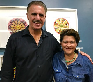 Wildlife photographer and Zoo Miami director Ron McGill with Collector Maria Freed at the Coconut Grove Arts Festival Gallery