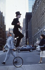 img049 (dzapp98) Tags: unicycle pare michel toronto 1983 downtown traffic eighties tophat blackjacket busker celebrate city 1984 sesquicentennial zapparoli david frontstreet intersections baystreet trafficlight poster suits