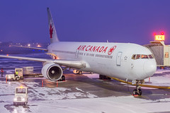 Frozen 767 (Ychocky) Tags: 50mmf18 aircanada boeing767375er cfoca cyow nikkor ottawamacdonaldcartier yow