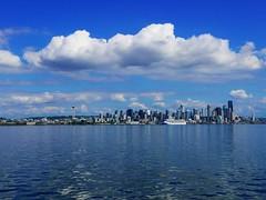 Seattle skyline (ekelly80) Tags: seattle bainbridgeisland ferry washington august2018 summer boat pugetsound water view skyline sky clouds buildings cruiseship spaceneedle