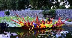 Reflecting Fiori Boat (pjpink) Tags: glass sculpture art boat water pond reflection biltmore biltmoreestate asheville northcarolina nc september 2018 summer pjpink 2catswithcameras evening