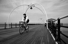 Pier (Manuel Goncalves) Tags: pier southport blackandwhite nikonn90s 35mmfilm epsonv500scanner england beach sea ocean bike ilfordxp2400