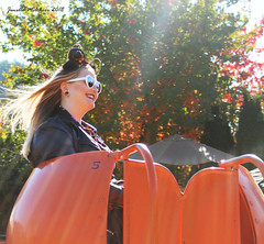 Flying Pumpkin No 5 (jenelle.melchior) Tags: person girl smile ride carnival flying pumpkin hair wind trees fall autumn light orange leaves farm halloween mickey ears disney