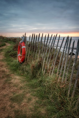 An Evening At The Beach (Rich Walker Photography) Tags: bantham beach devon landscape landscapes landscapephotography fence ring lifebuoy sunset cloud clouds canon england efs1585mmisusm eos eos80d coast coastal coastline grass sand