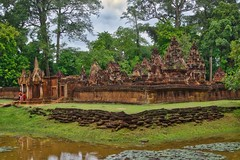 Banteay Srei temple ruins in Angkor Archeological Park near Siem Reap, Cambodia (UweBKK (α 77 on )) Tags: banteay srei temple ruins angkor archeological park ancient history historical archeology sandstone sandstein stone tree forest grass green water reflection architecture hindu hinduism shiva god siem reap cambodia southeast asia sony alpha 77 slt dslr