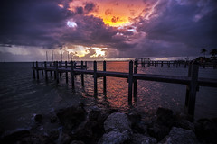 Darkness is Coming (lightonthewater) Tags: keycolonybeach florida floridakeys clouds sunset sky lightonthewater ocean sea pier rocks colorfulsky rain