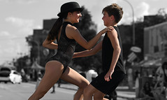 Who's Got It Now? (Anthony Mark Images) Tags: hat takingback dancerountine dancers boy girl comedy bojanglesdancestudios cute outdoors performance street stage belmontstreetfestival bestival kitchener ontario canada people portrait children monochrome blackandwhite selectivecolour blackcostumes nikon d850 smile sundaylights
