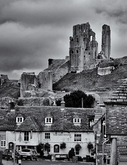 Towering above the village (David Feuerhelm) Tags: ruin nikkor castle buildings village corfe dorset cottages roof tiles motte old history historic england keep walls nikon d90 60mmf28micro