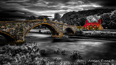 Llanrwst Ivy Cottage and Bridge (Adrian Evans Photography) Tags: ivy conwy arch bridge 15thcentury fall tuhwnti'rbont wales llanrwstbridge teashop uk british architecture pontfawr riverconwy conwyvalley welshlandscape cottage llanrwst landmark stonebridge courthouse outdoor welshlandmark stream entrance tuhwnti'rbonttearooms snowdonia longexposure sky riverbank victorian ancient virginiacreeper adrianevans autumn river building northwales forest landscape bridgeofswearing selectivecolouring on1 nikon