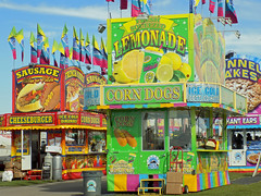 Big Rock Amusements Food Trailers. (dccradio) Tags: lumberton nc northcarolina robesoncounty outdoors outside robesonregionalagriculturalfair fair countyfair robesoncountyfair fun entertainment communityevent bigrockamusements carnival midway amusements amusementdevice rides outdooramusement lemonade funnelcakes sausage flag flags trashcan garbagecan grass lawn yard ground paved walkway pavement sky bluesky clouds corndogs cheeseburgers elephantears icecolddrinks food fairfood eat meal snack foodtrailer concessions concessionstrailer trailer colorful nikon coolpix l340 bridgecamera