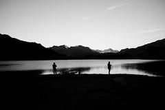 Fishermen @ Engstlensee (maekke) Tags: engstlensee engstlenalp silhouette mountain mountains alpen alps man switzerland streetphotography bw noiretblanc morning 2018 ch fujifilm x100t 35mm