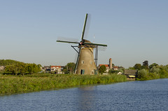 Holland (rschnaible) Tags: windmill kinderdijk netherlands holland unesco world heritage site history historic work production sightseeing wind power pump outdoor water landscape architecture building home house circa 1738 clear sunny day