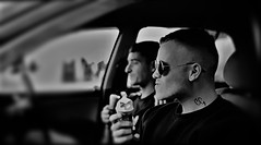 A Couple of Dudes in the Car. (ManOfYorkshire) Tags: guys lads tattoo car icecream dudes bros redcar northyorkshire chillin watching sunglasses men skinhead cropped