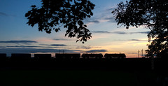 At sunset (Robert France) Tags: 2018 66182 90 90019 90029 bayhorse brel britain britishrailengineering cables catenary class90 db dbcargo dbschenker dbc dbs deutschebahn electricloco electriclocomotive electricpower electricrailway england freighttrainuk gec haulage hauling lancashire lancaster loco locomotive locomotives overheadline railroad railway railways silhouette silhouettes sunset sunsets train trains transport uk ukfreighttrain unitedkingdom wcml westcoastmainline