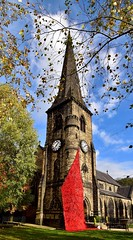 Poppies (rustyruth1959) Tags: rippondenfallingpoppies twigs branches leaves outdoor architecture cross sky october autumn trees poppies memorial wwi handmade poppydisplay fallingpoppies building religiousbuilding placeofworship religious village spire churchspire church stbatholomew'schurch ripponden calderdale yorkshire england uk tamron16300mm nikond5600 nikon alamy tower grass tree centenary