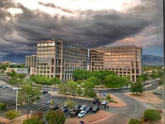 Uptown storm. Albuquerque, New México (mtm2935) Tags: mountainsbackdrop newmexico albuquerque uptown mountains sandia stormy storm clouds reflections glass architectural architecture buildings