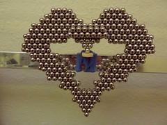 Balanced Heart - P1260951a (tend2it) Tags: neoball neocube buckyballs cybercube zenmagnet magcube nanodots magnet neodymium zen magnets zenmagnets cool magnetic sculptures art sculpture ball sphere catchy color silver reflections chrome balanced balancing heart frame popsicle stick shape love counter balance