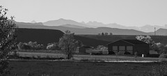 Distant Layers (trainmann1) Tags: nikon d7200 amateur colorado co fall october 2018 vacation trip scenic west blackwhite blackandwhite bw desaturated house building garage farm mountains haze distant mountain hills trees