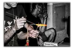 Glass chopsticks (Luigi Pallara) Tags: canon70d glass glasssticks fire streetphotography blackandwhite sticks torch lampworking glasschopsticks flame artistidistrada artists buskers artisan glassrods tolfa italia lazio italy tolfarte
