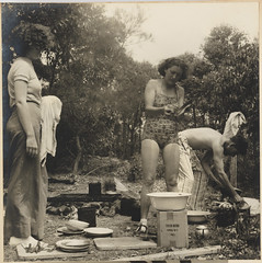 Olive Cotton washing dishes, Culburra Beach, 1937 by Max Dupain (State Library of New South Wales collection) Tags: maxdupain olivecotton sydney 1937 australian photographers photography sunbaker original