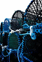 Crab Pots (the UMF) Tags: nobody vertical background basket bay blue catch coast coastal contrast copyspace crab england english equipment fishery fishing harbor industry lobster marine net north outdoors pattern photograph pot retro scene sea seafood seaside sky sunlight trap