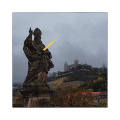 city of the saints 6 [All Saints' Day] (Armin Fuchs) Tags: arminfuchs würzburg altemainbrücke festungmarienberg festung fortress winter sword saints stkilian statue bridge clouds autumn