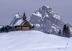 Church in Morschach, Switzerland, in the snow. (ivanstevensphotography) Tags: snow ski skiing trees mountains snowing