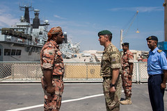 ROYAL MARINES MEET THE CREW OF AN OMANI WARSHIP.