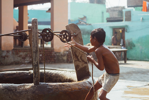 Boy Pulling Bucket From Well, Mathura India