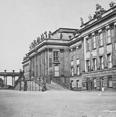 Sentry boxes and crowded pediments (National Library of Ireland on The Commons) Tags: joshuahhargravephotographiccollection joshuahhargrave nationallibraryofireland sentryboxes statues bridge drive outforeign locationidentified germany potsdam citypalace potsdamerstadtschloss 19thcentury baroque rococo architecture stadtschloss brandenburg europe sentries sunshades ramp