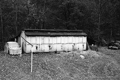 Abandoned and a bit ghostly (Drehscheibe) Tags: blackwhite analogica abandoned car nikonf2 nikkor50mm 35mm film hp5plus